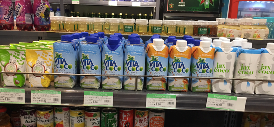 Imported coconut water product offerings on shelf